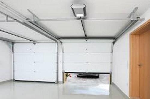 Automatisme porte de garage for Programmation telecommande porte de garage normstahl
